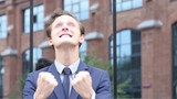 Successful Excited Businessman Celebrating Success, Standing Outdoor