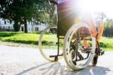 Man on wheelchair in a park
