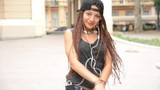 young handsome woman listening music with earphones and dancing