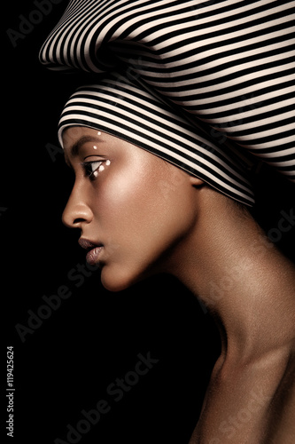 young beautiful fashion model with scarf and makeup on dark background Poster