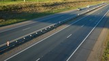 Cars moving on the highway. View from above. Sunset Dawn. Dusk. twilight.  time-lapse