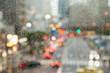 Defocused city view through rainy window