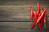 red chili peppers on dark wooden background