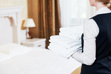 Hotel services. housekeeping maid with linen - 119503430