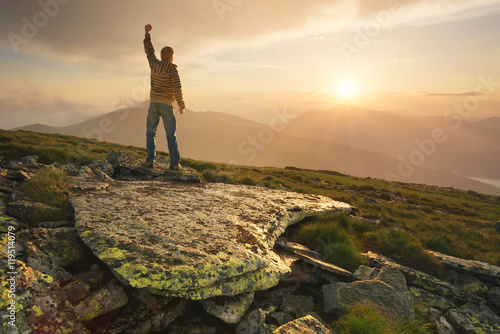 Papiers peints Morning Glory Winner silhouette on the mountain top. Sport and active life concept..