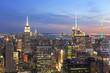 New York City skyline illuminated at dusk, US