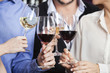 Cropped Image Of Friends Toasting Wine Glasses