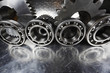 aerospace cogwheels and gears in titanium mirrored in brushed aluminum