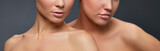 Close-up lips and shoulders of two younh girls with perfect skin over grey background