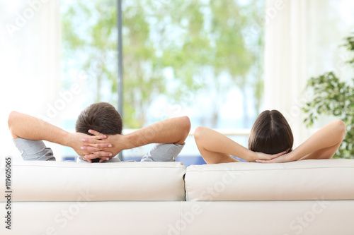 Poster Couple relaxing on a couch at home