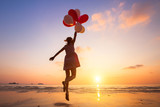 imagination, happy girl jumping with multicolored balloons at sunset on the beach, fly, follow your dream - 119619679