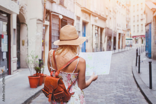 travel guide, tourism in Europe, woman tourist with map on the street - 119631816