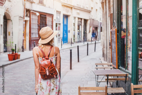 woman tourist on the street, summer fashion style, travel to Europe - 119631891