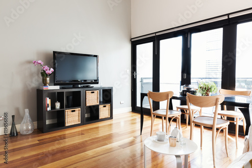 Modern apartment living room with bi fold door to balcony Poster