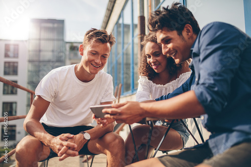 Group of people watching video on the mobile phone