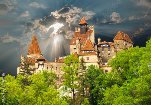Famous medieval castle of Bran in Brasov region, against the cloudy sky before t Poster