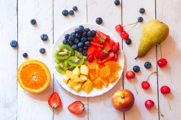 Ingredients for a fruit salad of rainbow colors © Maresol