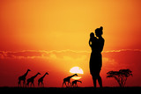 woman in African landscape at sunset