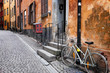 Sweden Stockholm quaint cobblestone street in historic district Gamla Stan. Parked bike