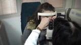 Eye Doctor, a test with young patient in his office