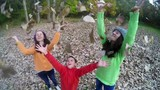 Three children throw autumn leaves, steadicam SLOW MOTION