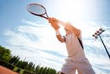 Sportsman on tennis court