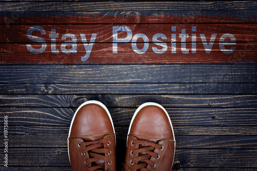 Stay Positive message and sport shoes on floor Poster