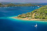 Fototapety Yacht cruising Kingdom of Tonga,  from above