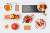 Jewish holiday Rosh Hashana mock up template with honey jar,apples and pomegranate. View from above. Flat lay