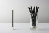 Individuality symbol and independent thinker concept and new leadership concept or individuality as a group of Pencil on white paper with one individual in the opposite direction as a business icon. - 119787669