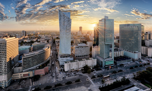 Fototapeta Warsaw city with modern skyscraper at sunset, Poland