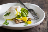 Crispy bread with avocado and poached egg