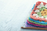 Pile of colorful granny squares - 119846884