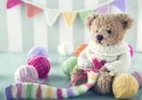 Teddy bear in a woolen sweater - 119846893