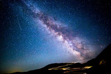 Milky way and traffic trails on Transalpina Carpathian pass, in Romania - 119855226