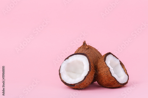 Fotobehang Purper Coconut on pink background. Minimal style. Two halves of coconut