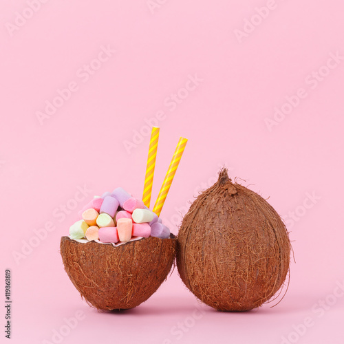 Fotobehang Purper Coconut milk with marshmallow in half coconut on a bright background. Minimal style
