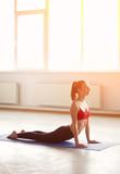 Young woman doing yoga cobra pose