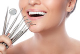 Smiling woman and dental tools