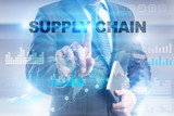 "Businessman is pressing button on touch screen interface and selecting ""Supply chain""."