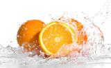 Fototapety Fresh oranges in splashing water isolated on white