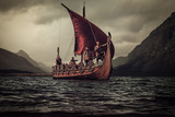 Vikings are floating on the sea on Drakkar with mountains on the
