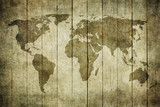 vintage map of the world over wooden background..