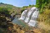 "Waterfall Chute de Djourougui in the region of Fouta Djallon in Guinea 119986484,Putting coin into the piggy bank"""