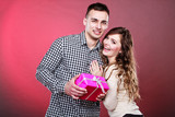 happy playful couple with gift box