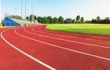 Fototapety Running track in a sports stadium