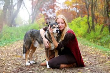 Peaceful Happy Woman Hugging German Shepherd Dog While Walking i