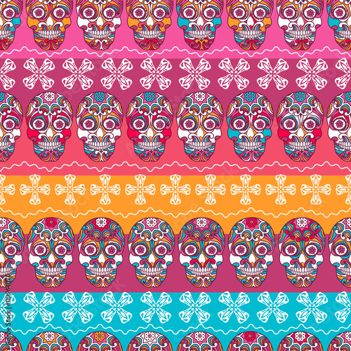 Multicolor seamless pattern. Boho strips decorated skull element. tribal texture
