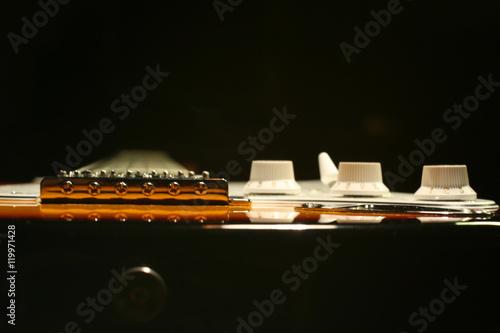Poster Vintage electric guitar on black background
