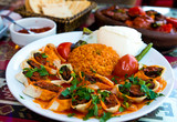 Traditional food in a Turkish restaurant, kebab with vegetables